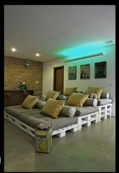 Turn old pallets into a comfy lounger or seat for a media room  Um...incredibly comfy?!