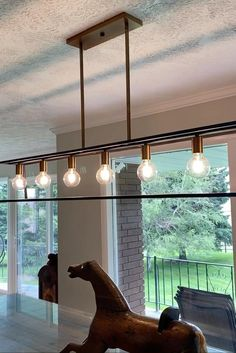 "Minimalist beauty emphasizes 'less is more' with vintage industrial style. This clean, airy tapered cage design is constructed without glass and the unique square candle sleeves rest on a discreet ""H""-shaped cluster. #diningroomlighting #farmhouse #farmhousestyle #diningroomchandelier #farmhousediningroom #islandlight"
