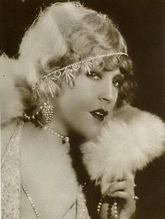 """Mae Murray.  Miss Itsy Poo of '22, and some (most) say the real life inspiration behind Norma Desmond.    """"Where are the cameras? Where are my flowers? I must be photographed with flowers! Get them before I'm surrounded by cameramen!"""""""