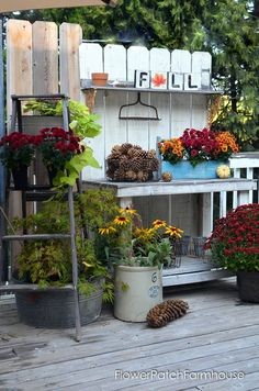 DIY Potting Bench decorated for Fall, lots of hand made projects included in the decor! FlowerPatchFarmhouse.com