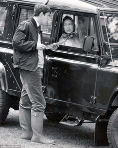 Queen Elizabeth II pictured in 1986 talking to Prince Andrew, Duke of York from the window of her Land Rover at Royal Windsor Show.
