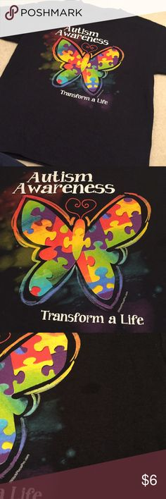 Autism Awareness T-shirt Never worn but seems to be a spot on it. It's pictured. It may just be the screen print. I bought this for my daughter to wear for Autism Awareness day at school . She never wore it because it was too big after we received it.  Size is youth medium but looks larger Shirts & Tops Tees - Short Sleeve