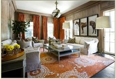 source: Melanie Turner Interiors White & orange living room design with orange drapes, orange medallion rug, white slip-covered sofas and chairs, horse art Sandy Chapman zodiac pendant and brass floor lamps. Orange Rooms, Living Room Orange, Casas En Atlanta, Living Room Designs, Living Spaces, Living Rooms, Living Area, Muebles Shabby Chic, Family Rooms
