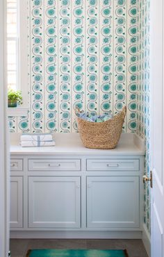 Andrew Howard Interior Design | Fun turquoise wallpaper for the laundry room