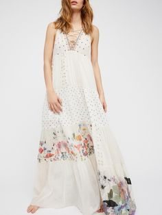 Hera Maxi Dress | Beautiful bohemian maxi dress featuring lace-up details at the neckline, tribal-inspired embroidery, crochet cutouts and a mixed print design.      * Flowy silhouette * Unfinished edges for a lived-in look * Lined