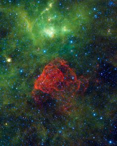 Remnants of a supernova explosion, captured by Nasa's Wide-field Infrared Survey Explorer. The explosion that ended the star's life would have been visible on Earth some 3,700 years ago. The expanding shock waves have heated up dust and gas clouds, setting them glowing in infrared