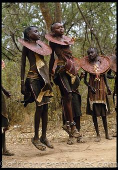 Newly initiated Pokot girls at the climax of the ceremonies of the rite of passage leap and shake their ornate beaded collars. Kenya   ©Angela Fisher and Carol Beckwith (African Ceremonies)