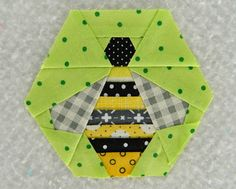 Paper pieced bee block....s.o.t.a.k handmade has a link to the printable free pattern ♥