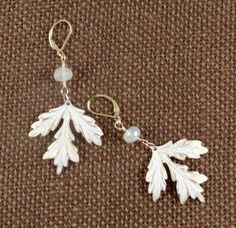 Winter white oak leaves. prayed with Ivory Krlon and buffed back and sealed. The stones are stunning grapefruit Chalcedony. The ear hooks and wire are 14k goldfilled.