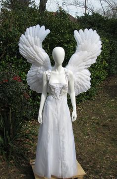 Upswept super large feather angel wings are over three feet from top to bottom