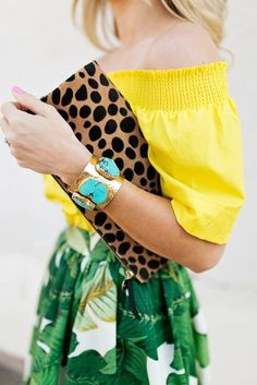 Palm print and bright colors just scream summer! Try sporting this fun print with your favorite bold hues this season, and don't be afraid to add other minimal prints and statement jewelry!