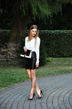 White blouse, leather skirt and Louboutin.