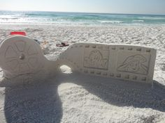 Disney Movie Reel Sandcastle, Ariel and Flounder on the side, Mickey and Bambi on the other,  Sandcastles by Mike Bradley
