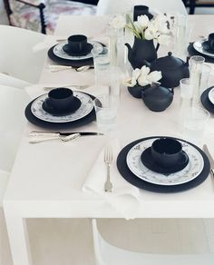 You really can't go wrong.  A few choice noir accents and  playful graphic flourishes can  elevate everyday plates to  a dramatic tablescape of  light and shadow   domino.com