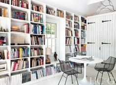 The couple's office, formerly a garage, is outfitted with bookshelves from California Closets, an Ikea table, and an ABC Carpet & Home area rug.