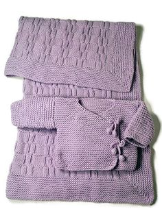 """Pie is a garter stitch baby kimono with basketweave blanket framed in a mitered garter band. Shown in size Newborn (3 mos) Directions are for infant's Newborn size (3 mos). Changes for sizes Small (6 mos) and Medium (9 mos) are in parentheses. Finished Measurements Chest (closed) – 19(21-23)"""" Length – 9(10-11)"""" Blanket – 36"""" square Materials 4(5-6) Balls Berroco Pure Merino(50 grs), #8510 Wisteria for Sweater, 13 balls for Blanket"""