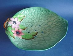 A very pretty and vibrantly coloured salad drainer from the uncommon clematis range by Carlton Ware Sometimes seen as a small jam dish larger pieces Earthenware, Stoneware, Vintage Thrift Stores, English Pottery, Carlton Ware, Clematis, Vintage China, Ceramic Pottery, Decorative Bowls