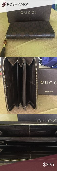 Authentic Gucci bamboo tassel wallet. Gucci Bamboo tassel wallet in dark brown leather with signature GG signature. Item was used a couple of times but in pristine condition. Comes with original packaging and tags. Gucci Bags Wallets