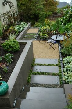 this smaller backyard is landscaped to maximize space includes an acid etched concrete retaining