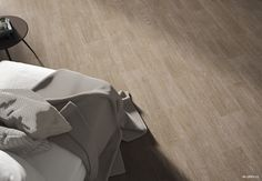 It looks like #wood, it's #ceramic…#livingroom #livingarea #salón #salones  #pamesa #ceramica#pamesaceramica #porcelain #home #floortiles #walltiles #flooring #interiors #azulejos #revestimiento#fliesen #carrelage #architecture #interiors#design #trends #arquitectura #design#madera #reformas #revamp #deco#decoración #designlovers #projects#bathroom #tileslover Tote Bag, Wood, Tiles, Bedroom, Architecture, Woodwind Instrument, Timber Wood, Totes