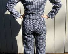 Leisure Suit. A suit worn in the 1970s by men. This a more casual look, worn with bright colors and patterns. The suit is composed of a pants and a suitjacket that matched.
