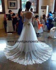 Backless brocade wedding dress with train