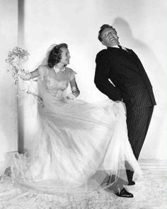 publicity shot of June Allyson as Martha Terryton wearing wedding dress and kicking Van Johnson as Greg Rawlings.
