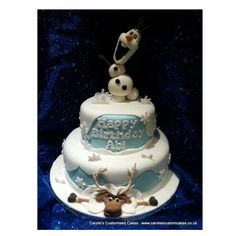 A Frozen cake featuring Olaf and Seven.