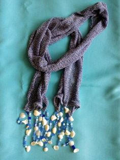 Knit scarf with beaded and shell drops $10