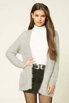A fuzzy knit cardigan featuring two front pockets,  an open front, ribbed trim, long sleeves, and a longline silhouette.