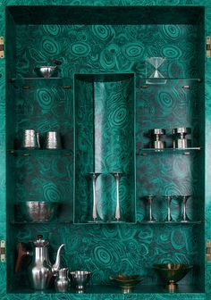 Piero Fornasetti's malachite trumeau (tall cabinet, c.1952) filled with Finnish mid-century modern design: Sterling silver candlesticks, bowl and coffee set by Tapio Wirkkala for Kultakeskus Oy (1950-1960s), an hourglass made of plexiglass also by...
