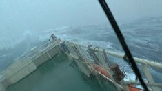Dramatic footage, filmed 100 miles out at sea, has emerged showing what it's like on a large ship during a major storm.