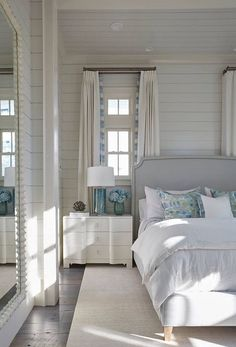 Light blues and neutrals create a calming coastal casual bedroom