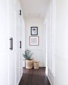 Home Decor Ideas. Gave our hallway a mini makeover with a few things I had around the house! Im thinking an art lamp above the prints would be the perfect addition. I love my new faux olive branches more than my real ones. Hallway Walls, Upstairs Hallway, Long Hallway, Hallway Ideas, Hallway Cabinet, White Hallway, Hallway Art, Entry Hallway, Wood Walls