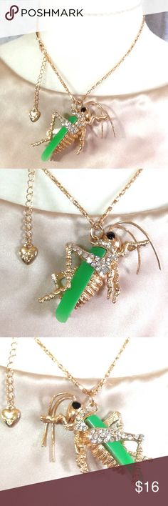 """NWT!  Grasshopper Whimsical Pendant Necklace Pendant measures:  1 1/2""""L x 2 1/2""""W  (with moving antenna)  and hangs on a 28""""L fancy chain with extender chain, logo heart and lobster clasp closure.    Comes Nestled in a Fancy Organza Gift Bag.  NEW - NEVER WORN Jewelry Necklaces"""