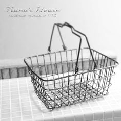A wire shopping basket by the amazing Tomo Tanaka. In a later blog entry he shows it filled with bathroom goodies, but I love the basket on its own too.