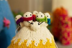 A knitted hat with mini snowmen on top! This would be so cute!!!