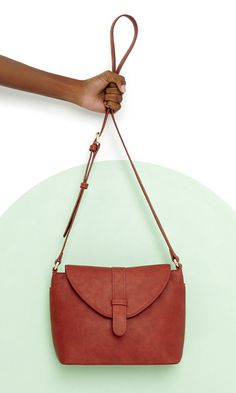 Vegan leather crossbody bag with a fold-over front closure