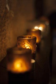 A light in the darkness Devine Light, Candle Jars, Candle Holders, Caramel Delights, Spotlight Lamp, Candels, Shades Of Gold, Caramel Color, Festival Lights