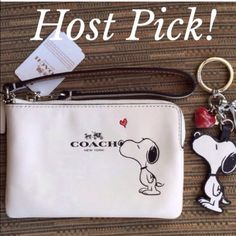 """Coach & Snoopy Wristlet & Keychain NWT Limited Edition Peanuts Snoopy Collection.(Sold Out Per Coach Website)  ✨Crafted of Coach's Top Quality calf leather in stylish white.  (Calfskin is particularly valuable because of its softness, and fine grain and grain patterns as well as its durability). ✨There are (2) multifunctional slot pockets on the inside of Wristlet  ✨Measurements 6 1/4"""" (L) X 4"""" (H) ✨This Wristlet is brand new with tags attached and product care card. ✨Note:These (2) Items…"""