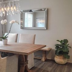 #MirrorMonday: neutrals + reflective surfaces make @lavieestbelledesign's space stunning. Features our Reflection Mirror, Linear Crystal Strand Chandelier and  Archer Dining Table.