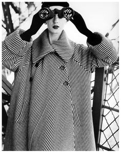 Dovima in a Balenciaga coat. Photographed by Richard Avedon at the Eiffel Tower,  August 1950.