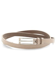 For that patterned shift that needs a discreet cinch, or those high-waisted pants that could use an effortless finishing touch, this tan belt is your easy fix! A thin, leather accessory boasting a uniquely long silver buckle, this neutral belt is sure to become your go-to accessory when in need of a simple addition to a chic look.