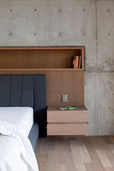 Work of Pitsou integrated into bed frame from Molteni & Co. Italy