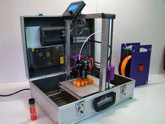 http://technabob.com/blog/2015/05/14/teebot-3d-printer-in-a-suitcase/