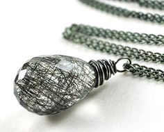 Rutilated Quartz Necklace. Gemstone Jewelry. Tangled. Wire Wrap Necklace. Oxidized Sterling Silver.. $36.00, via Etsy.