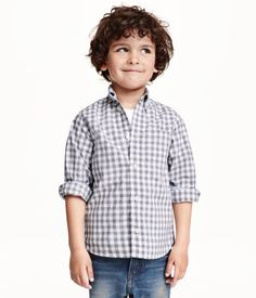 Long-sleeved shirt in soft, washed cotton with button-down collar and a chest pocket. Buttons at front and at cuffs.