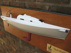 """* This is the 25"""" half hull model of the J/125 sailboat.  The model is mounted on the figured Mahogany backboards. The model dimension is 25"""" (L) x 9""""(H) x 4""""(D). The size of the backboard is 30""""(W) x 12""""(H). The Model scale is 1/20. The model weight is 11 LBS. ................. Please contact Mas at halfhull@gmail.com or visit the web at www.halfhull.net for more model information.    Zuma Boat (404) 272-7889."""