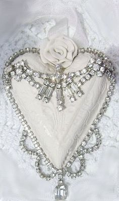 White clay heart adorned with vintage rhinestone jewelry, from Crystal's Rose Cottage Chic.