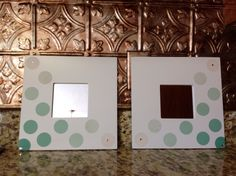 IKEA Malma mirrors decorated with scrapbook paper cutouts.